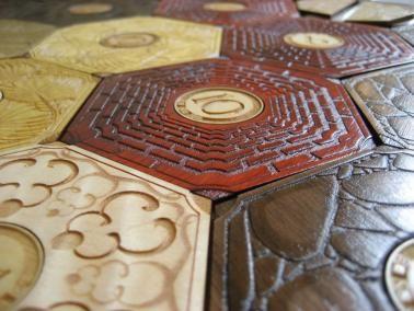 Versão belíssima de madeira do jogo de tabuleiro Catan