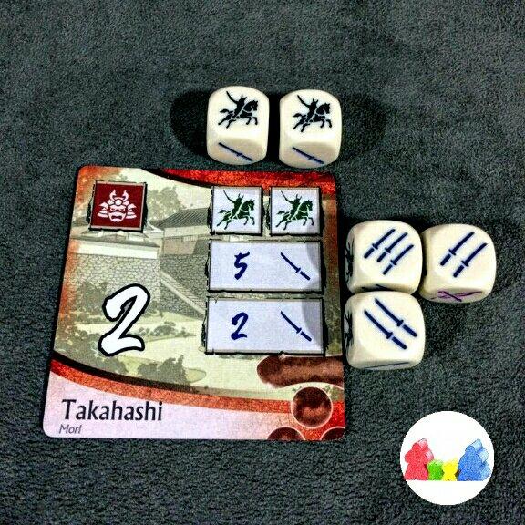Um castelo sendo conquistado no jogo de tabuleiro Age of War