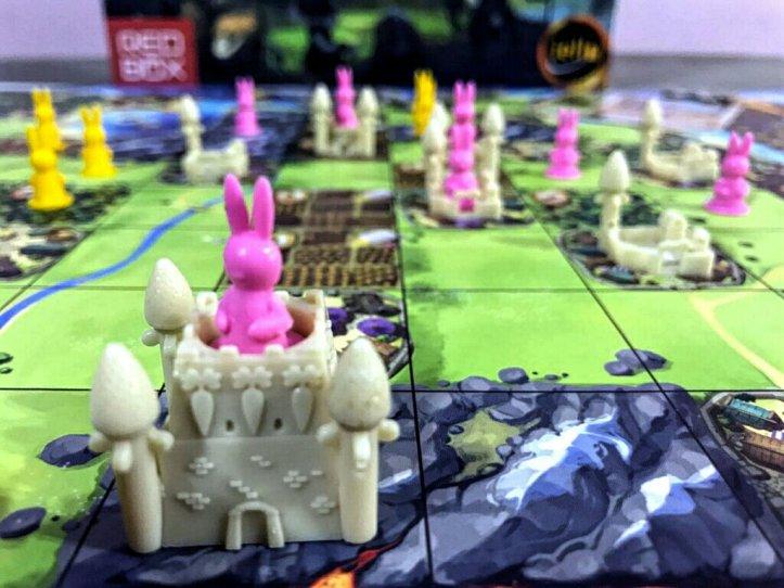 Cidades com três torres no jogo de tabuleiro Bunny Kingdom