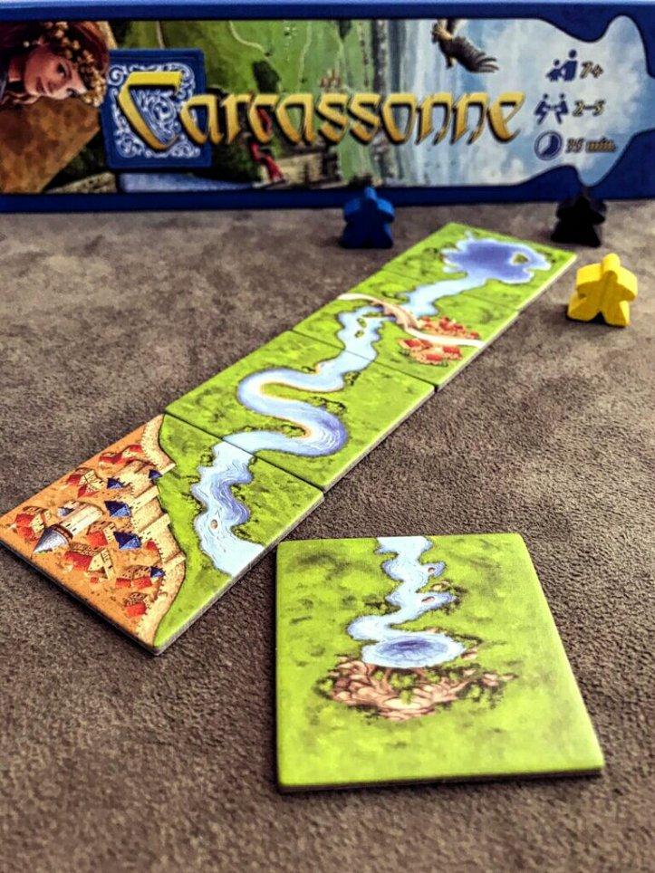 Mini expansão Rio no jogo de tabuleiro Carcassonne